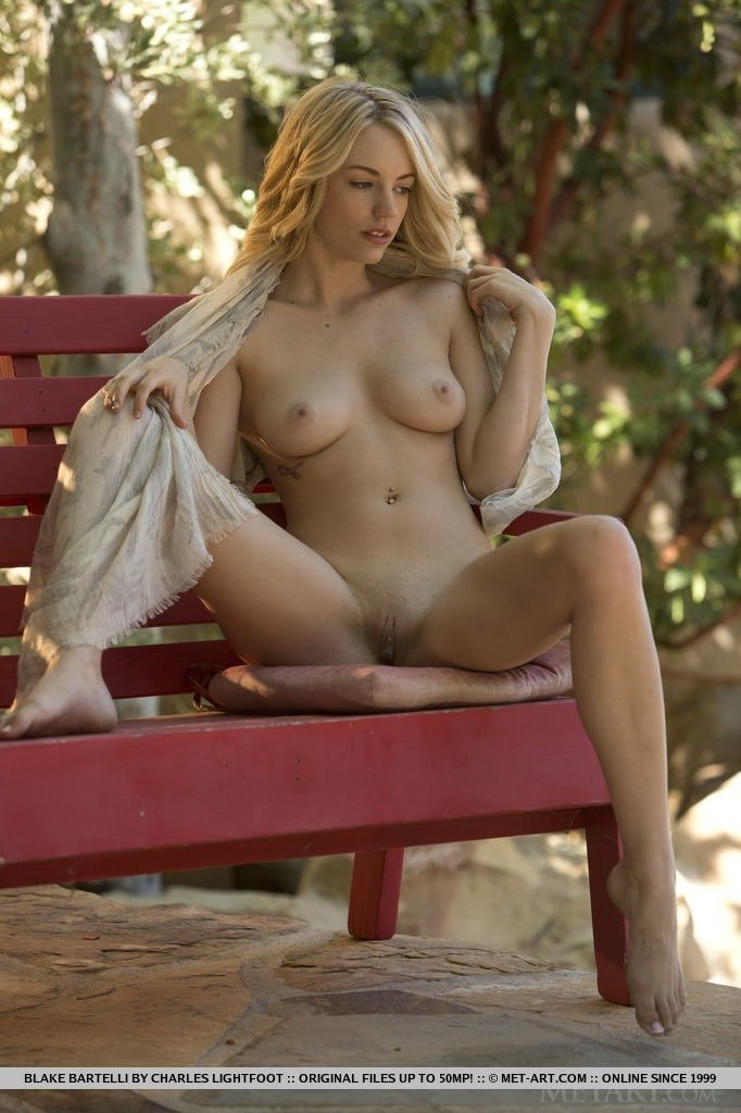 sexy blonde topless in the park